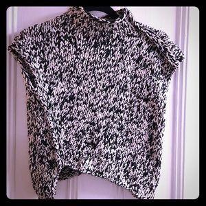Black and ecru asymmetrical knitted crop top